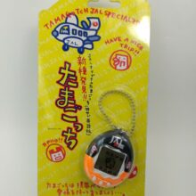 Tamagotchi Original P2 JAL Black w/ orange Bandai 1997