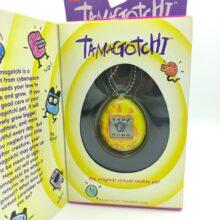 Tamagotchi Original P1/P2 Yellow w/ orange Bandai 1997 English