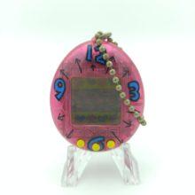 Tamagotchi Original P1/P2 Clear pink w/ blue Bandai 1997
